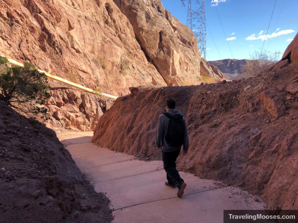 Man walking towards Hoover Dam