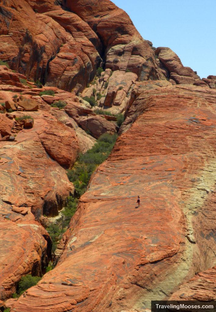 Hiker exploring red rock canyon