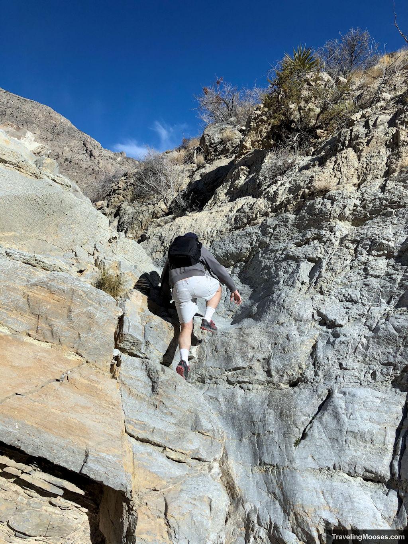 Man scrambling up gateway trail