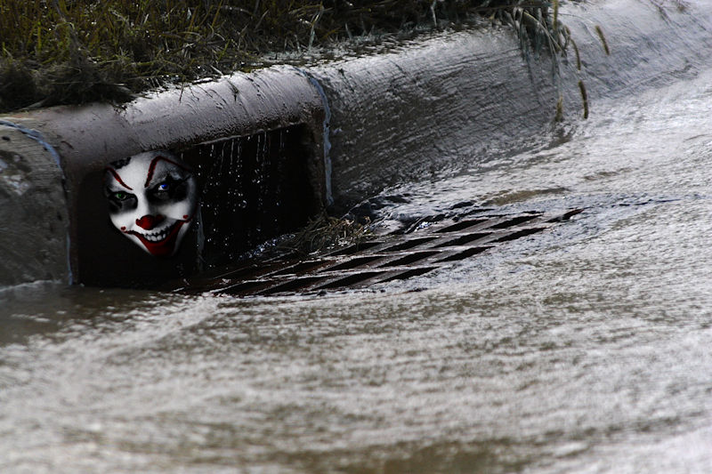Clown in storm drain