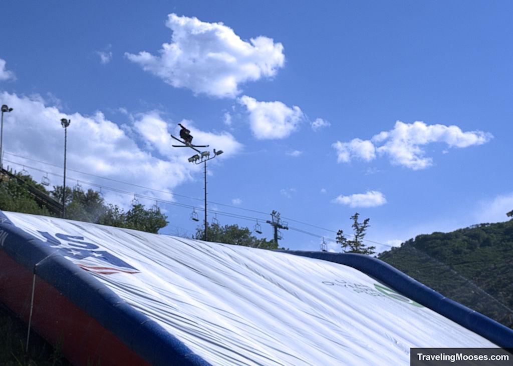 Airbag practice ski jump at Olympic Utah Park - skier shown doing a jump