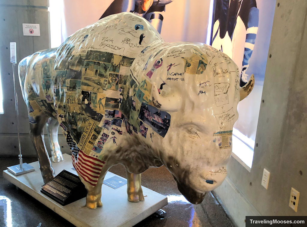 2002 Olympic winter buffalo statue with Olympian signatures and pictures of athletes