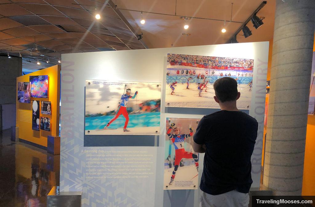 Man looking at winter olympics exhibits at George Eccles Salt Lake Musuem