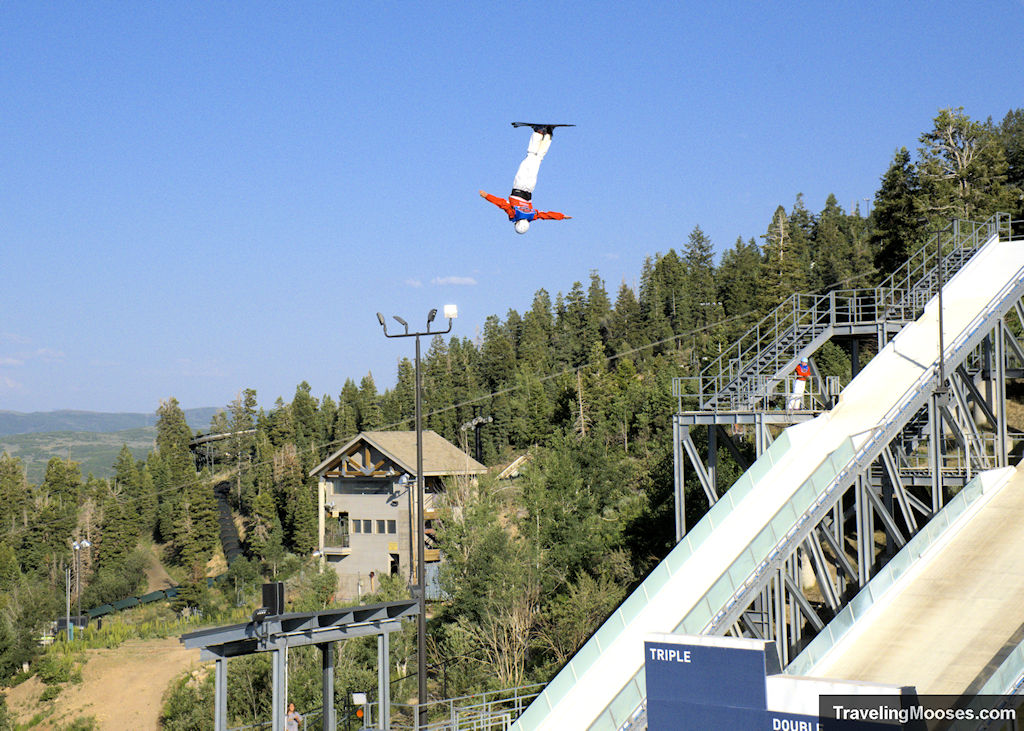 Man upside off ski jump in Flying Ace All-star freestyle show