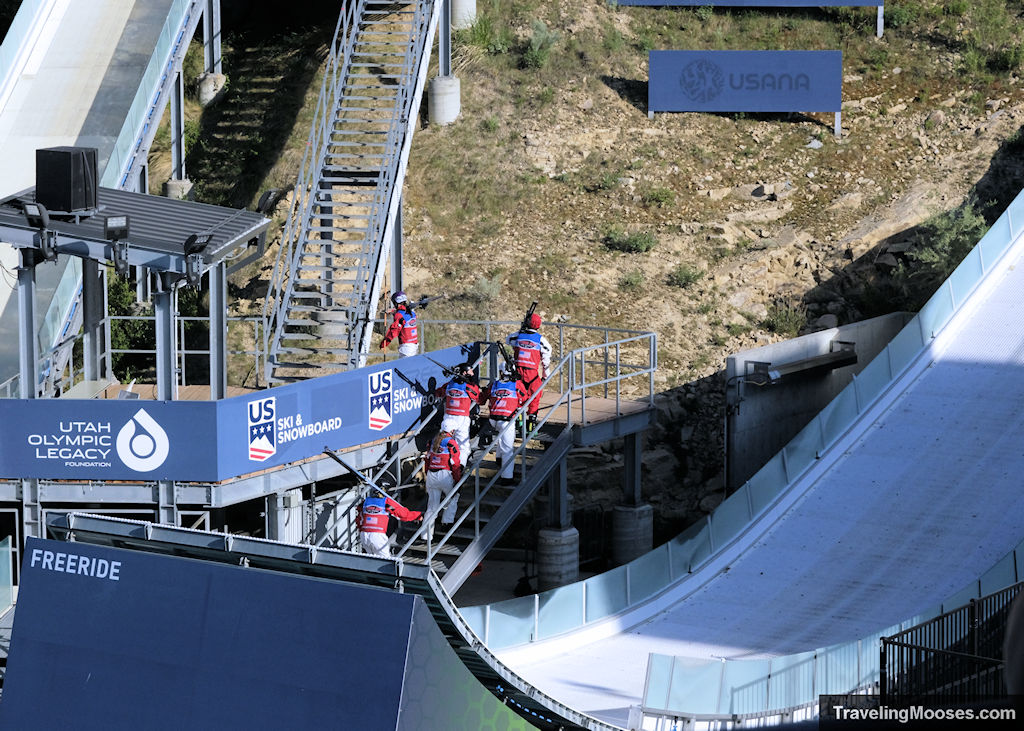 Freestyle show participants walking upstairs with their skis